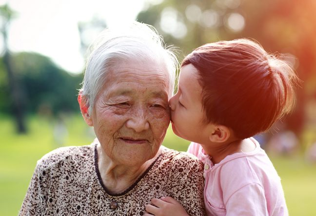 Tender moment between (奶奶)Nǎinai and her grandchild
