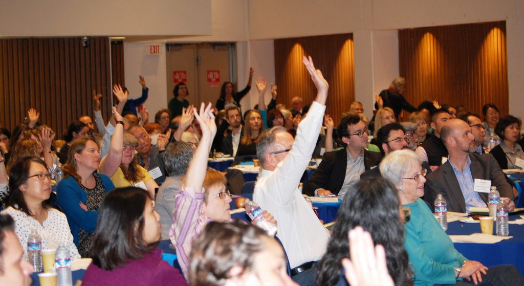 The audience participates in a question and answer session at the 2016 Elder Abuse Conference